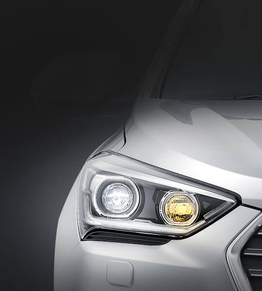 Bi-function HID headlamps with LED positioning lamps