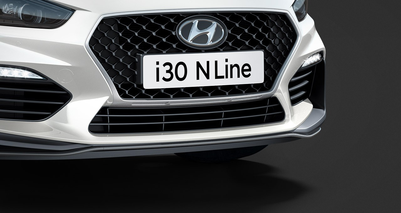 Exclusive grille and sculpted bumper